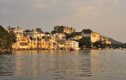 Udaipur, Rajasthan, India. View of the old city waterfront Royalty Free Stock Photo