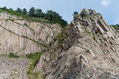 Udde Stolbchaty, geografisk udde på den östliga kusten av den Kunashir ön av Sakhalin Oblast, Ryssland arkivfoton
