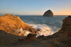 UddeKiwanda solnedgång, Stillahavs- stad, Oregon Fotografering för Bildbyråer