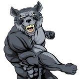 Uderzać pięścią wilczej maskotki Fotografia Stock