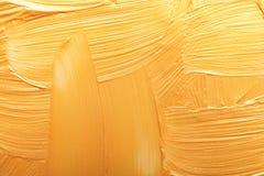 Uderzenia złocista farba jako tło zdjęcie stock