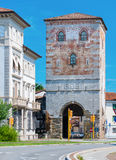 Udine - August 2016, Italy: Old Tower with city gate in historic center of Udine (Cultural center) Stock Photo