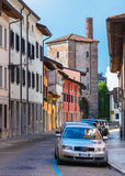 Udine - August 2016, Italy: Street view with old Tower - City Gates and colored houses in traditional style Royalty Free Stock Images
