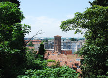 Udine Framed by Trees. A tree-framed view of the historic north eastern Italian town of Udine. This shot is taken from the castle and shows some of the town's Royalty Free Stock Photos