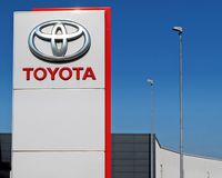 Toyota logo in the dealership of the area, against blue sky.  It is the symbol of the   japanese vehicle manufacturer. Udine, Italy. June 29 2019.Toyota logo in stock image