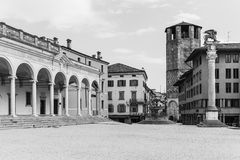 Udine - March of 2016, Italy: Old tower and historic buildings on the Square of Liberty, black and white Stock Images