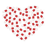 The uditsinsky capsules lying in the form of heart Royalty Free Stock Images