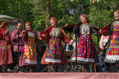 Udmurt state folk song theatre aikai concert at the festival. Gerberas royalty free stock image