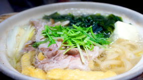 Udon hot pot prok with vegetable and seaweed Royalty Free Stock Images