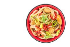 Udon japanese noodles with red chilli. Pepper in red bowl isolated on a white background Stock Photos