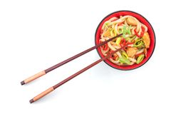 Udon japanese noodles with red chilli. Pepper in red bowl isolated on a white background Royalty Free Stock Images