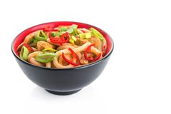 Udon japanese noodles with red chilli. Pepper in red bowl isolated on a white background Stock Images