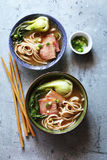 Udon noodle soup with pork belly in bowls Royalty Free Stock Image