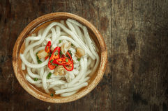 Udon noodle in wood bowl on wooden floor background Stock Images