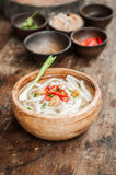 Udon noodle in wood bowl on wooden floor Royalty Free Stock Image