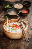 Udon noodle in wood bowl on wooden floor Stock Photos
