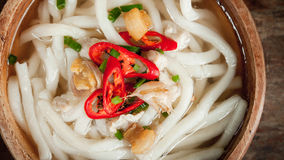 Udon noodle in wood bowl on wooden floor Stock Image