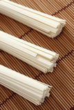 Udon noodles on bamboo napkin. Close-up Stock Photos