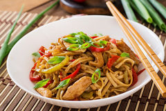 Udon noodles with chicken and peppers Stock Photos