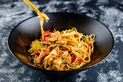 Udon noodles with chopsticks royalty free stock photography