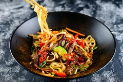 Udon noodles with chopsticks royalty free stock photo