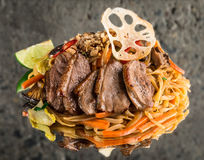 Udon noodles with duck breast Stock Photography