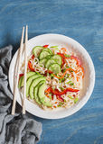 Udon noodles with quick pickled vegetables and avocado on a blue table. Healthy vegetarian food Royalty Free Stock Photo