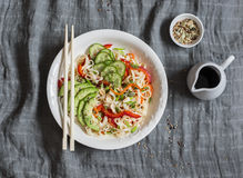 Udon noodles with quick pickled vegetables and avocado on a gray table, top view. Healthy vegetarian food Stock Photos