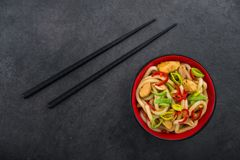 Udon noodles with red chilli pepper. And green leek in bowl. Spicy asian food Stock Photos