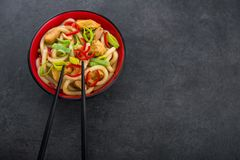 Udon noodles with red chilli pepper. And green leek in bowl. Spicy asian food Stock Photography