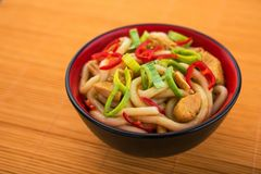 Udon noodles with red chilli pepper. On wooden table. Spicy  japanese food Royalty Free Stock Image