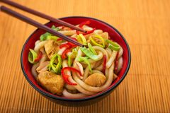 Udon noodles with red chilli pepper. On wooden table. Spicy  japanese food Stock Image