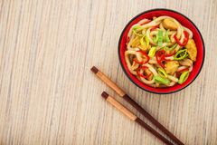 Udon noodles with red chilli pepper. On wooden table. Spicy  japanese food Stock Photos