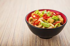 Udon noodles with red chilli pepper. On wooden table. Spicy  japanese food Royalty Free Stock Photo
