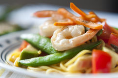 Udon noodles and tomato salad stock photography