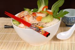 Udon noodles with vegetables and seafood with chopsticks Stock Images