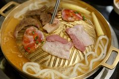 Udon and Pork grill on BBQ brass pan. royalty free stock images