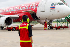 UDON THANI, THAILAND - OCTOBER 6, 2015: Air Asia staff on ground in the airport Royalty Free Stock Images