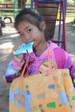 Asian girl is drinking milk. stock photo