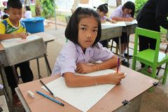 This girl is drawing a picture. UDONTHANI, THAILAND – JANUARY 12, 2018: Drawing, this girl is drawing a picture on the table, for sends it to her teacher stock illustration