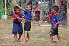 Playing to enjoy together. UDONTHANI, THAILAND – JULY 15, 2019 :  Thai student group is playing to enjoy together on the field in SPORT DAY royalty free stock photography