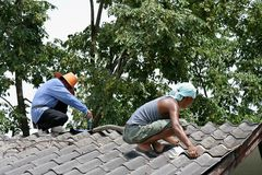 They are repairing roof. stock photo