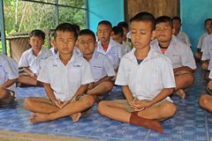 Student is training the concentration. UDONTHANI, THAILAND – MAY 16, 2018:  Students,  sit for training the concentrate,  be morality of Buddhism,  that they Stock Images