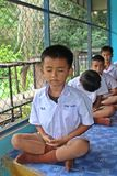 Student is training the concentration. UDONTHANI, THAILAND – MAY 16, 2018:  Students,  sit for training the concentrate,  be morality of Buddhism,  that they Stock Photos