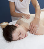 Udvartana massage with chick-pea flour. Indian technique for peeling and toxins removal Royalty Free Stock Photos