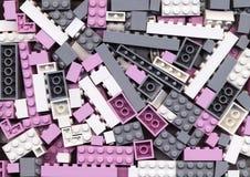 Udział menchie, szarość i biel, Lego blokuje tło Zdjęcia Royalty Free