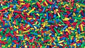 Udział różnorodny barwiony zabawkarski cegły tło obrazy stock