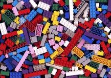 Udział różnorodny kolorowy Lego blokuje tło Zdjęcie Stock