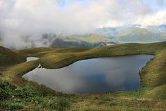 The Udziro lake near Bakurkhevi village (Georgia). Udziro lake is located near Aragvi river, after Bakurkhevi gorge in Caucasus Range. There are a lot of very Stock Photo