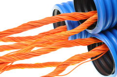 Ue corrugated pipe with orange cables Stock Photography